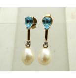 Atelier Christian Gouden oorbellen met topaas, diamant en parel