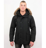 Tony Backer Lange winterjas met grote bontkraag
