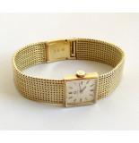 Christian Gouden omega horloge