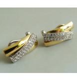 Christian 18 karaat gouden oorbellen met diamant wit goud