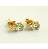 Christian Gouden oorbellen met aquamarijn en zirkonia geel goud