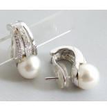 Christian 18 karaat oorbellen met parel en diamanten wit goud
