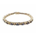Christian 14 karaat armband diamant en saffier geel goud