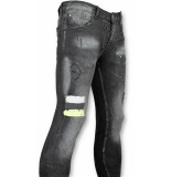 Addict Heren spijkerbroek met verfvlekken zwart