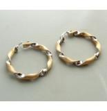 Christian 14 karaat bicolor gouden gedraaide oorbellen
