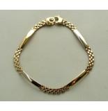 Christian 14 karaat bicolor gouden schakel armband geel goud